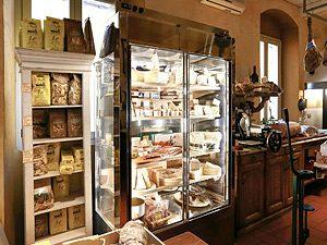 Vitrine murale et armoire réfrigérée pour exposition de fromages
